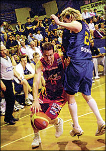 Melbourne Tigers guard Matt O?Hea drives past Brisbane?s Dillon Boucher in Saturday?s night?s final of the Virgin Blue NBL Blit
