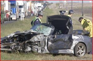 Police inspect the Honda sedan.Pic KEV FARMER