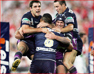 Antonio Kaufusi (8) is mobbed by teammates Cameron Smith (feft), Nathan Friend (centre) and Cooper Cronk. Pic: AAP IMAGES