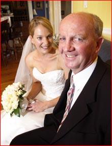 Dan Flanagan removed his eye guard for his daughter Katherine's wedding photos. Pic Scott Fletcher