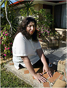 FIRDOUS Todiee outside her Terranora Road home that she and her husband