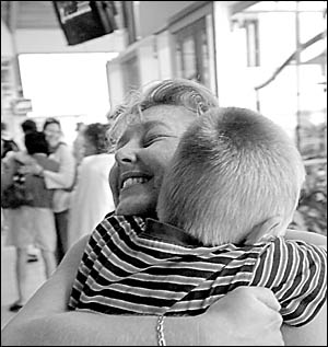 Nothing was going to convince Tina to let go of her son, Tyler, at Coffs Harbour Airport yesterday, after 12 months without him