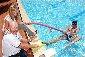 ?Hey matey, flippers are not allowed? . . . Mick Maley and Angela Van Den Bosch surprise Paul Herber doing secret training for