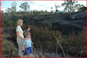 Barbara Simon and  sons Connor and Jack survey the work of arsonists. Pic: Charles Johnston