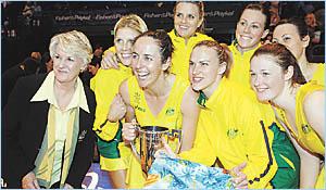 Australian netball coach Norma Plummer, left, captain Liz Ellis, third left, Sharelle McMahon and Susan Pratley celebrate their