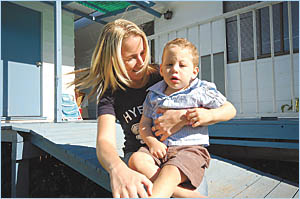 With no government support because she is from New Zealand, Sarah Dunick is struggling to care for her severely disabled son, K
