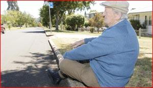 Karel Hanzlicek sits in the gutter under a tree, in Hillside Street. Pic: Bev Lacey