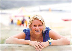 Sawtell?s Courtney Hancock . . . all smiles after competing in the gruelling Coolangatta Gold. Photo: TREVOR VEALE