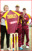 Jimmy Maher (middle) and Lachlan Stevens present Di Thorley with a Bulls shirt. Pic: Nev Madsen