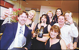 How sweet it is ... Mark Wolf (left) and his support crew celebrate their coup at the 2006 Coffs Coast Business Awards.