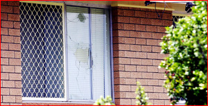 The window of this High Street home in Rangeville was shattered. Pic: BEV LACEY