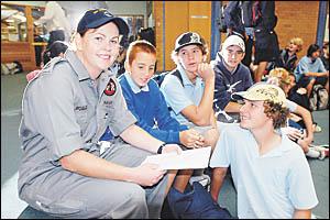 Leading Seaman Aviation Technician Tammy Rodgers talks to Woolgoolga High School students, Marc Fisher, Glenn Turner, Ben Guiho