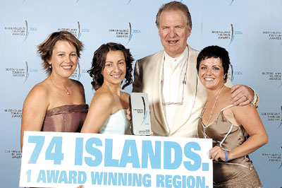 Hume Campbell and the Fantasea Cruises team accept the Significant Tourist Attraction Award at the QLD Tourism Awards