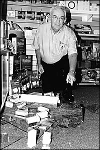 Shattered . . . David Ford inspects the damage to his shop yesterday morning.
