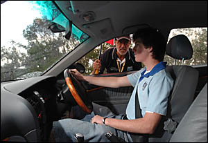 Grafton High?s Zac Edwards, 16, gets some final words of encouragement from driver trainer Ian Douglas at the Mountainview driv