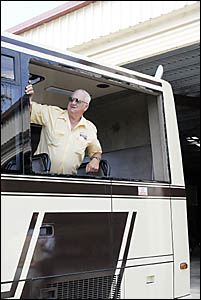 Dirty deeds . . . Jim Woodhill had a rock come through this window on his bus last week.
