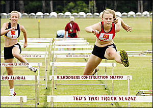 Brianna McCabe races away to win the 90m hurdles. Photo: TREVOR VEALE