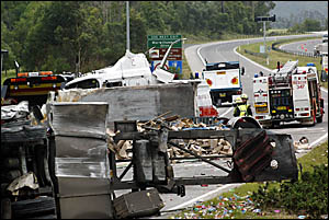 Scenes of devastation following yesterday?s crash of a B-double transport carrying ice-cream at the entrance to the tunnel unde