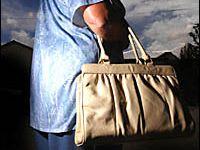 Woman dragged beside car after handbag snatch