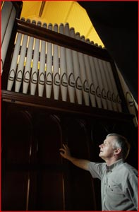 Friends of the Empire vice-president Richard Chiverell admires the organ.  Pic: Kevin Farmer