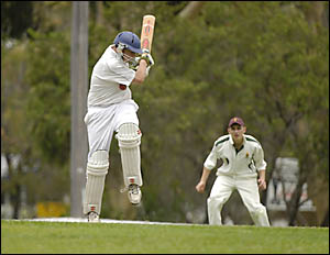 Opener James Bellamy takes a painful hit to the breadbasket on his way to an unbeaten 57 for Diggers.