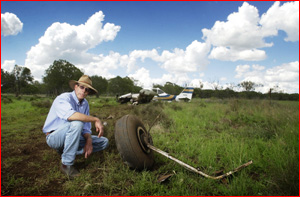 Roger Douglas with what is left of the crop sprayer.Pic: Kevin Farmer