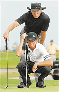 Greg Norman, pictured with son Gregory, pulled strings to get his black hat to Nambucca Heads in time for Sunday?s Elly Stig Me