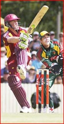 Clinton Perren launches a big hit at Heritage Oval under the gaze of Tasmanian keeper Tim Paine. Pic: SCOTT FLETCHER