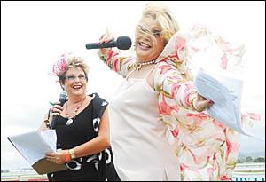 Ebullient entertainer Carlotta  (right) amuses Rescu Beauty Bar Fashions on the Field MC Jenny Child atCoffs Harbour Racing Clu