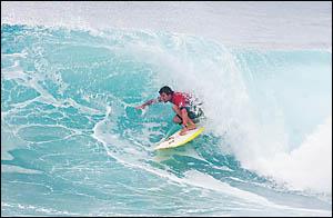 Harley Ingleby finds himeself a nice tube ride at Flinders on the Mornington Peninsula.    Photo: Surfing Australia