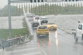 Downpours flood dry district