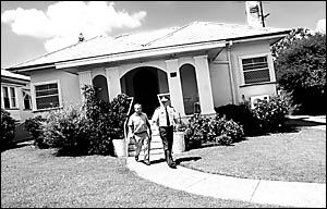 Crime prevention officer Senior Constable Michael Hogan (left) and Superintendent Bruce Lyons conduct a doorknock during investigations into the 2000 death of Lismore man Peter Allen.