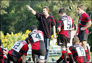 Paul Butcher at work with Coffs Rugby . . . leading official Des Hoy believes the quality of coaches and administrators keeps t