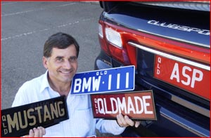 John Aspromourgos with some of his collection of personalised number plates. Picture: Kevin Farmer