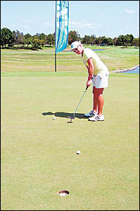 Suzie Fisher on the practice green at Royal Pines