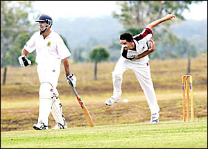 TWEED bowler Leigh Baker sends down another delivery during the final of the Webb Shield n Ipswich yesterday while batsman Bria