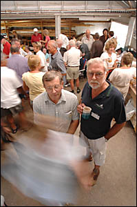 Clarence Valley U3A president Allan Woods with member Colin Wood in among the bustle of the group?s sign-on day at the Men?s Sh