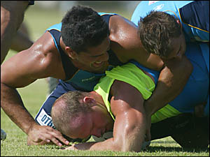 GOLD Coast frontrower Luke Bailey is tackled by teammates as the Titans prepare for tomorrow night?s pre-season showdown with M