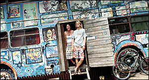 TOP-NOTCH: Hanging out on the ?Love Bus? at the Byron Bay Arts Factory complex are Arts Factory hostel manager Peggy O?Neill an