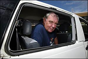 TONY Phillips looks through the shattered window of his van. Photo: CRAIG SADLER