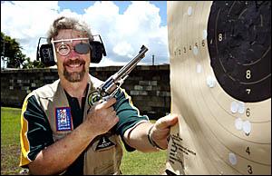 MURWILLUMBAH Pistol Club secretary Jonathon Clough checks his grouping at the club?s pistol range. The club has an open day on