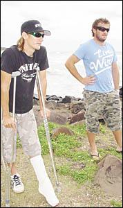 : Shark attack survivor Matt McIntosh (left), of Goonellabah, revisits Ballina?s Angels Beach for the first time since his terr