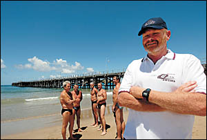 Ocean Swims organiser Mick Maley is happy to stay on dry land as participants head into the water for a last minute swim around