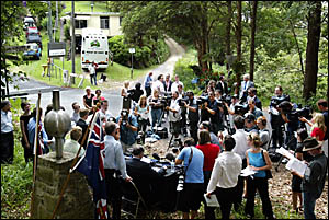 p THEREwas standing room only at the border crossing at Tomewin when a large media contingent was bussed-in to the secret locat