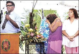 EMOTIONAL RESPONSE: Githabul people at Woodenbong yesterday (from left) Uncle Doug Williams, Aunty Christine Charles holding Au