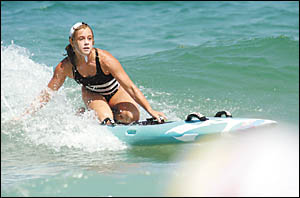 Sawtell?s Jazmin MacMillan rides a wave in during last weekend?s under 14 girls board relay final of the Westpac NSW Age Surf L