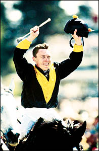 DEFENDED:The sister of  jailed former Casino jockey Chris Munce, pictured winning the 1998 Melbourne Cup with Jezabeel, says sh