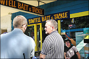 Sawtell crime spree . . . Owen Crossley (right) talks to Senior Constable Dave Mantella outside Sawtell Bait and Tackle yesterd