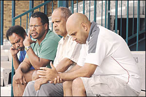 SHOCKED: Members of the Northern United Rugby League Football Club pictured at Crozier Oval yesterday (from left) Steve Robert