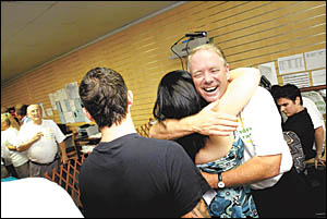 Oh, happy days ... Andrew Fraser celebrates his election night victory with supporters at his campaign headquarters.